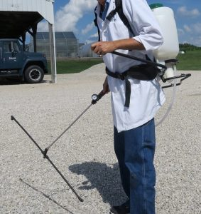 Figure 2. This backpack sprayer has three nozzles on a boom and a hand-pump that can be worked constantly.